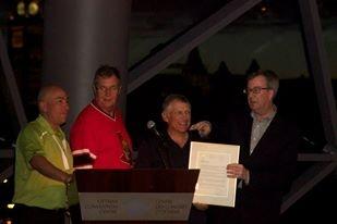 Ottawa Mayor Jim Watson recognizes Jim Robinson's 17 years with Tamarack Ottawa Race Weekend at the President's Reception.
