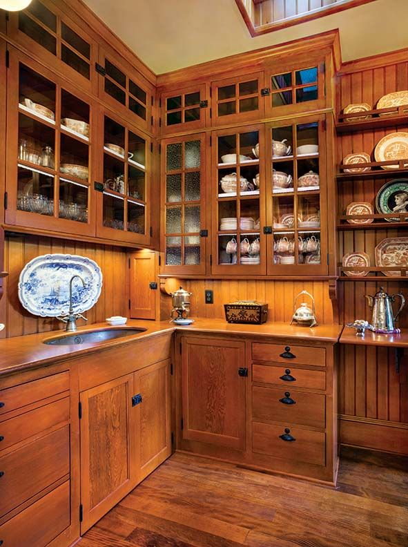 Cabinets in the butler's pantry were designed by Matthew Roman and built by Mike Edeen, complete with wood countertops. Vintage Florentine glass (with texture) was used in two cabinet doors; the rest are fitted with hand-blown restoration glass.