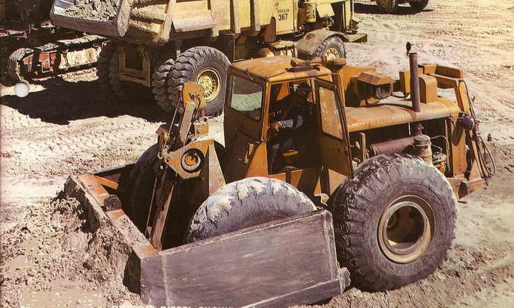 Cleaning up around shovel operations was a task that the Tournatractor was ideally suited for due to it's speed and manoeverability. Fitted with a factory cab, this machine has plates welded over the bulldozers side arms to prevent rocks from slicing the front tires