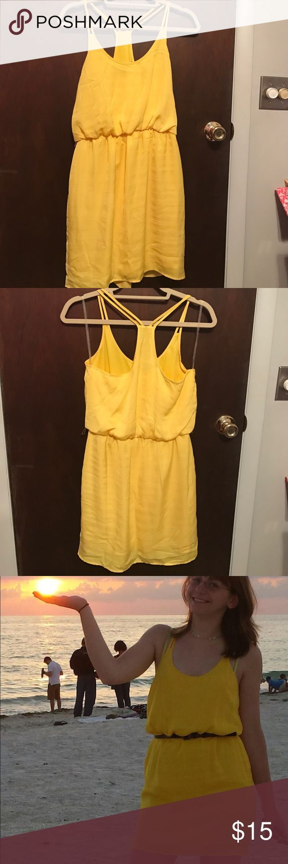 Yellow Sundress Yellow Sundress that comes with a brown belt. Pairs nicely with tan sandals/wedges. There is a layer underneath that can be a bit tight in the hips. City Triangles Dresses Mini