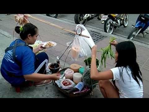 papaya salad prepared by a street vendor