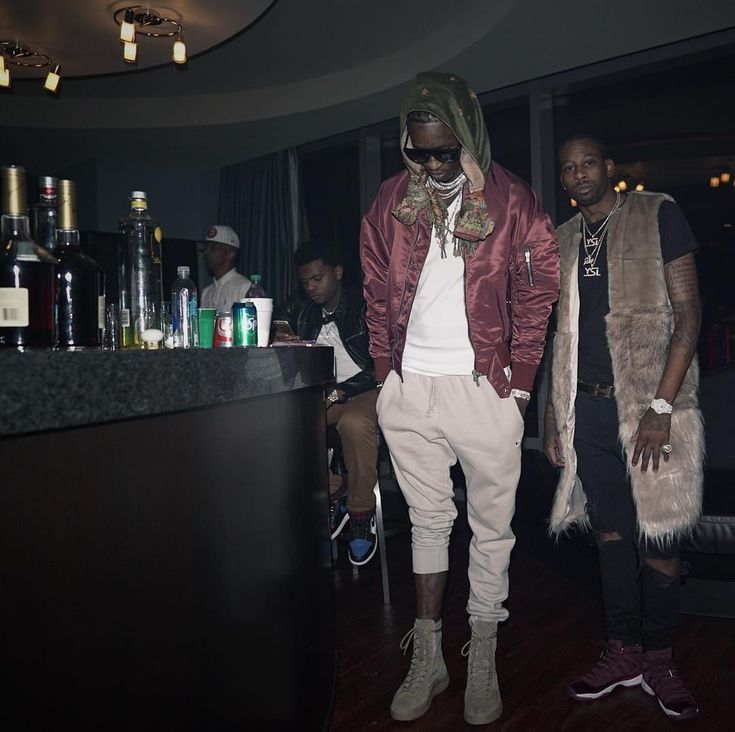 Pictures of young thug wearing dresses with leggings