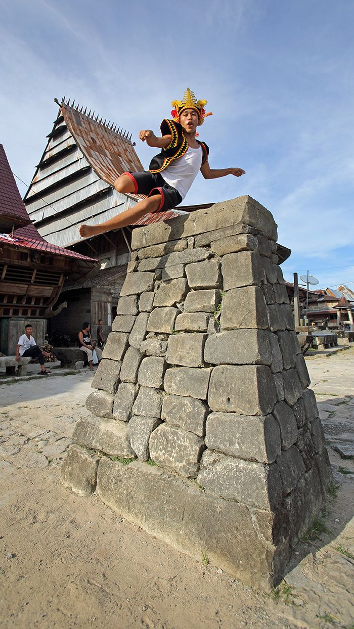 Stone jumping is one of the most famous cultural practises on Nias Island. The jump used to be an initiation for warriors. Today it is still practised in a few traditional villages in the south. Bawömataluo village, South Nias. #Indonesia. Photo by Bjorn Svensson. www.visitniasisland.com