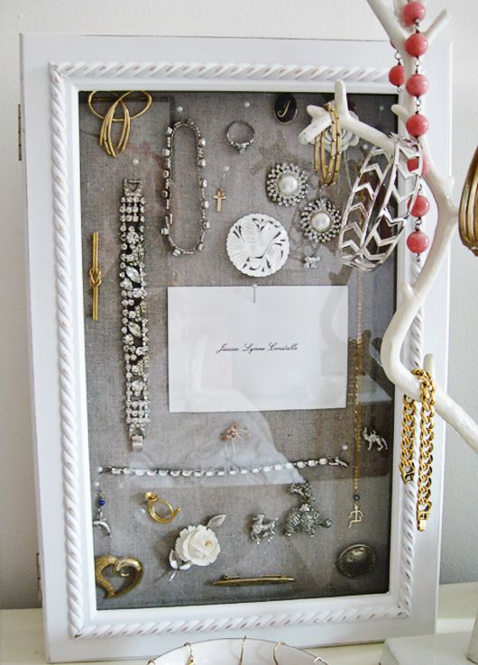 "i LOVE this idea of pinning ""momento jewelry"" (handed down from grandmothers, etc) inside a shadowbox frame and it doubles as art! :)"