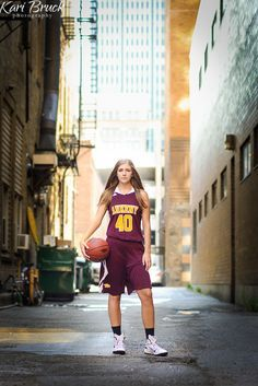 2016 High School Senior girl for posing picture ideas. Senior girl basketball player in an urban location. Image by Kari Bruck Phootography, Des Moines, Iowa.
