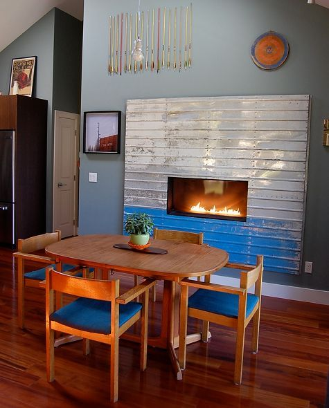 An old found bus door becomes a new frame for a fireplace #diy
