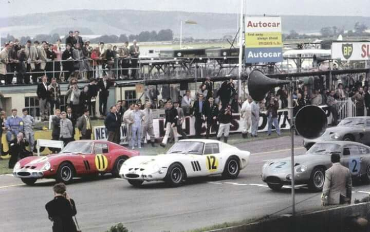 1963 RAC TOURIST TROPHY, GOODWOOD : START 1-Graham Hill, Ferrari 250 GTO #11, John Coombs' (Winner) #4399GT 2-Mike Parkes, Ferrari 250 GTO #12, John Coombs' (2nd) #3729GT 3-Innes Ireland, Aston Martin DP214 #2, David Brown (7th) #DB4GT0194R (ph: thechicaneblog.com)