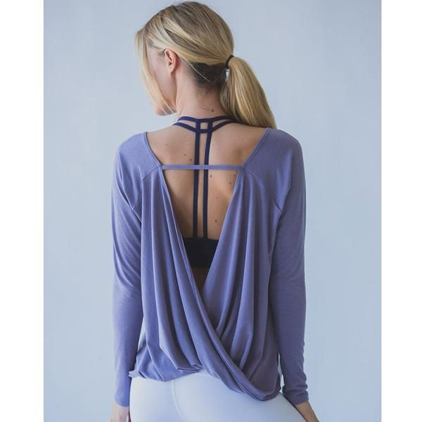 The open back yoga top is sure to make a standout addition to your growing active-wear collection. These trendy yoga tops feature an open back that will show off your favorite sports bra as you get your workout on. It is perfect for low impact exercise and lounging on those lazy days. Choose from purple, black, or white colors that can mix and match with all of your favorite yoga leggings and bras. Grab yours today, stylish yoga tops are now trending. Note: Only one long sleeve shirt is…