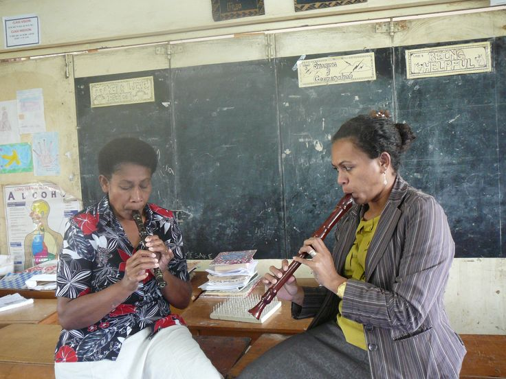 teachers playing the recorders we donated