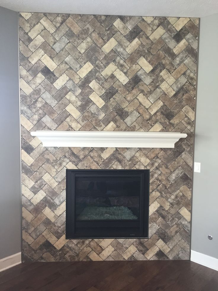 Awesome brick fireplace! Style of tile is called New York and the color is Broadway