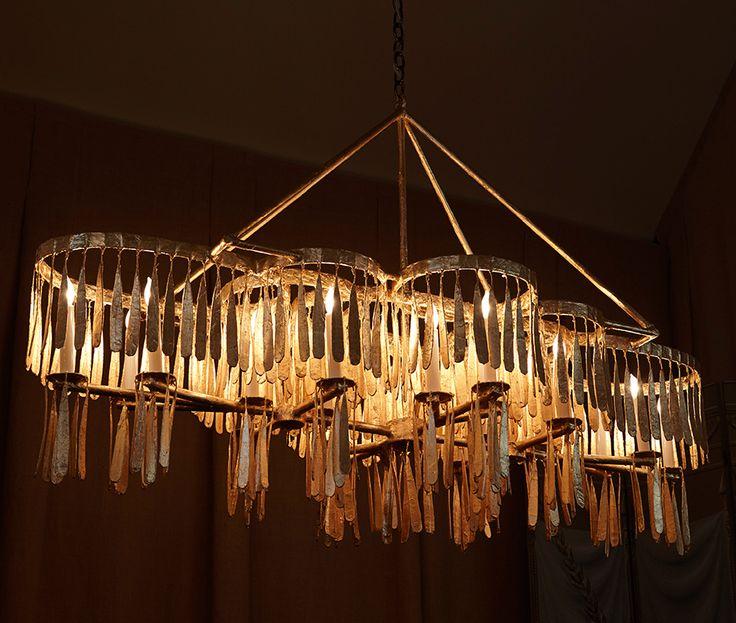 The midas plank chandelier has 20 lights with candelabra bases we recommend maximum 25 watt light bulbs