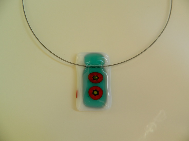 Fused white and transparent turquoise glass pendant with little flowers in it