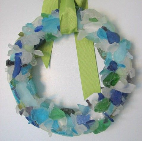 This wreath inspired me to make one for our front door. TIP: use clear silicone caulking to adhere the sea glass, it works wayyyy better than that foam glue junk.