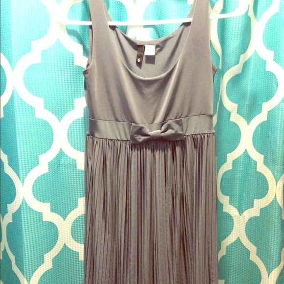 Dress This dress is so cute on, fits perfect, silky/stretchy material. I'm 5/3 and 130 lbs and this dress fits perfect. Like new!!! No stains & smoke free home Bulgari Dresses