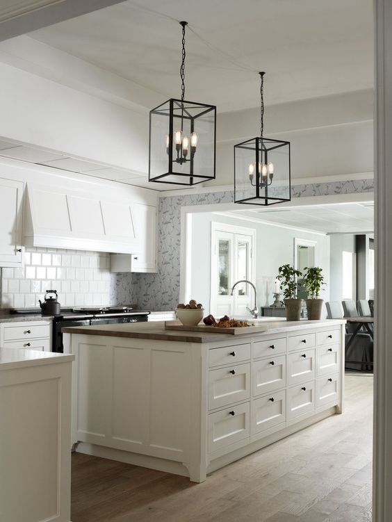 Adding Interest To The White Kitchen Hoods