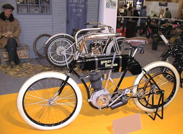"How Harley and his childhood friend Arthur Davidson created their ""first"" motorcycle in 1903. Harley-Davidson ""The First"" by William Harley, Arthur and Walter Davidson; model ""0""; monocylinder; 400 cc; 1-speed; year 1903. Photo taken at the Mondial du deux roues in Paris, 2003. Source"