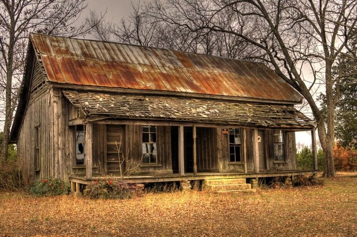 Abandoned Tiny Cabin With Rusty Corrugated Metal Roof