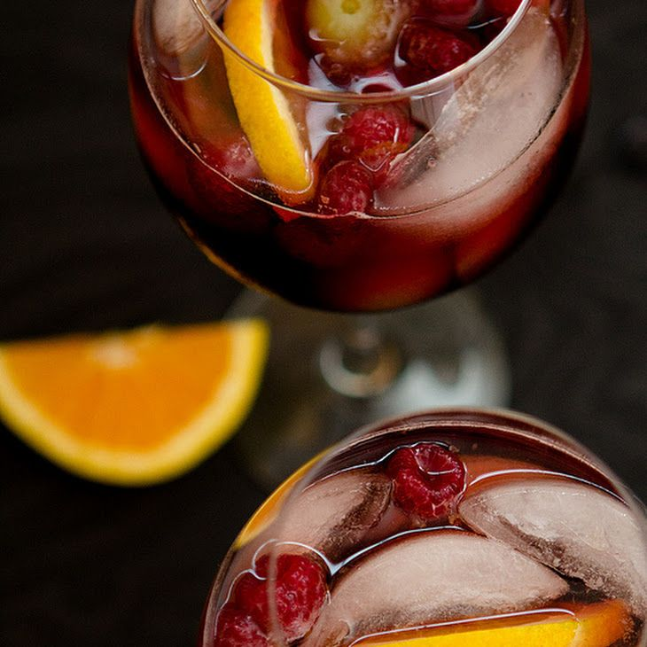 Spiced Pomegranate Sangria Recipe Beverages, Cocktails with sangria, pomegranate juice, schnapps, brandy, ginger ale, raspberries, grapes, orange, ice cubes