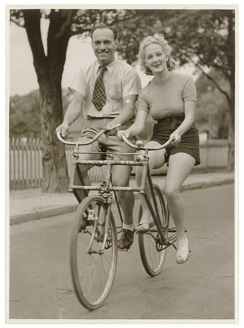 Man and woman on a Malvern Star abreast tandem bicycle, circa 1930s, by Sam Hood.