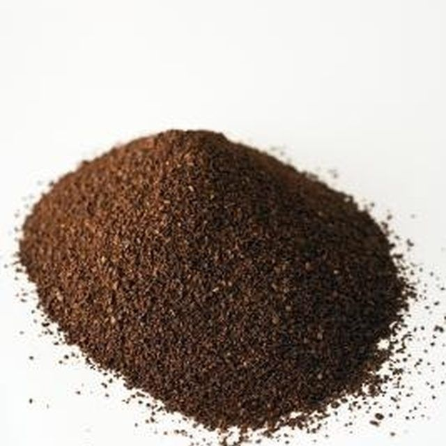 Aged coffee grounds kill mosquito larvae in water.