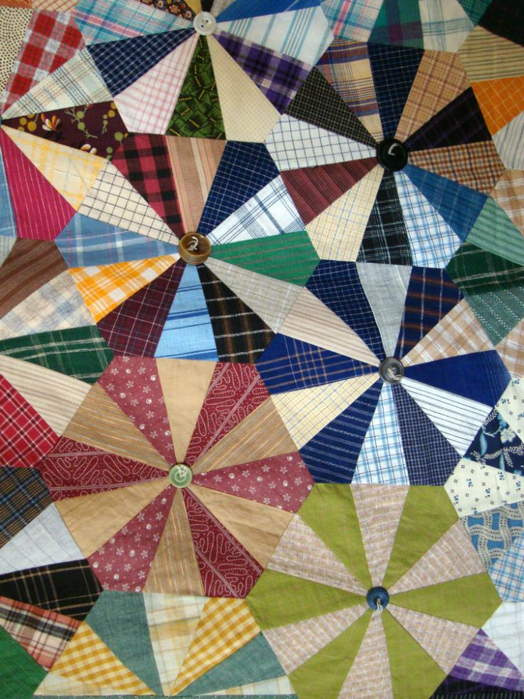 close up, Endless Chain (Wheels) quilt by Glenna Hailey at Hollyhock Quilts.  Made with new and antique plaid and striped fabrics, finished with buttons
