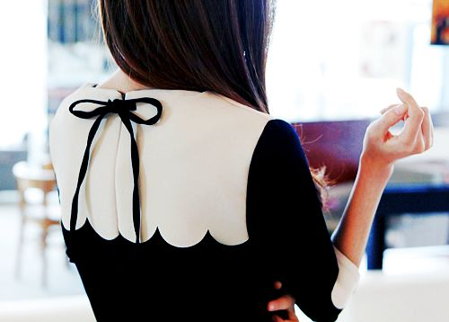 The back is an often-neglected facet of clothing; I love the bow and scalloped detailing in this blouse.