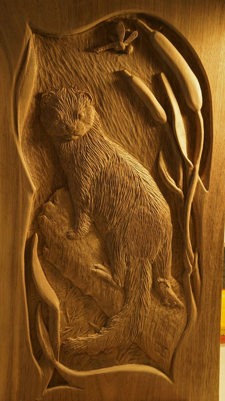 Lpostrustics a carving by jillian post of mink