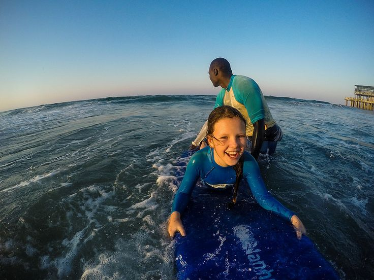 Learning to surf at Addington Beach, Durban, KwaZulu-Natal, South Africa | by South African Tourism
