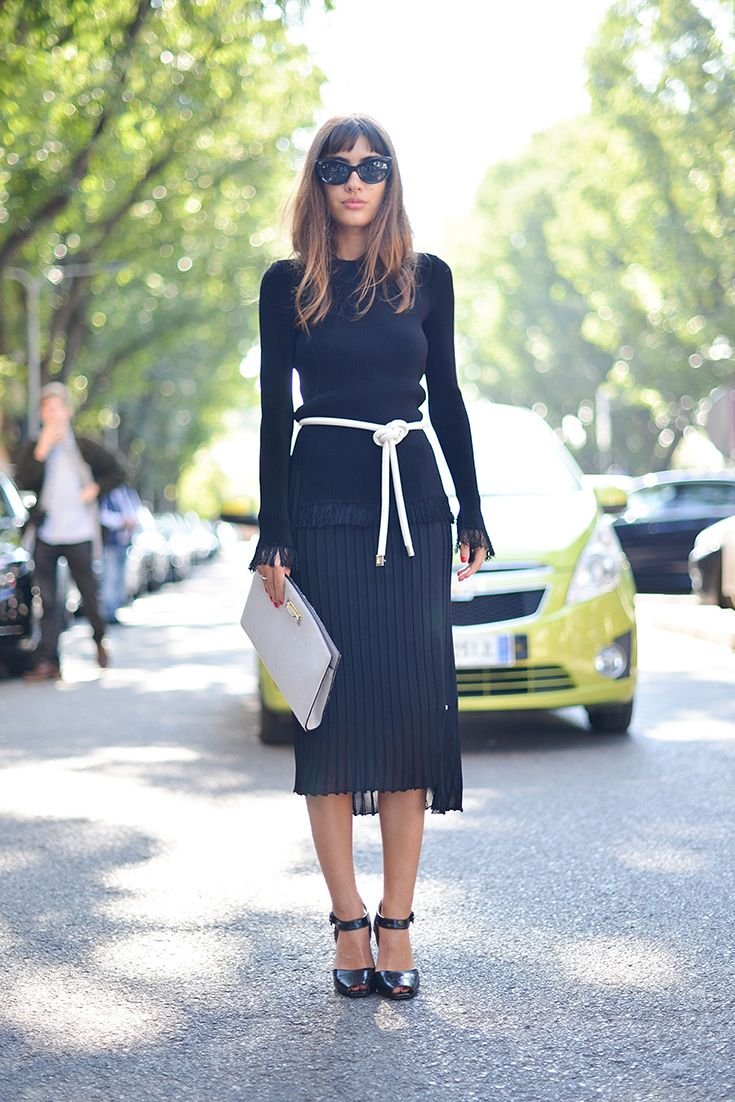 Take your fashion cues from street style: see how this savvy show goer swaps out a trad belt for a knotted rope to give shape to a midi dress.