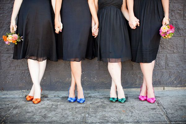 Unique way to incorporate color into your bridesmaids attire while still letting them wear black dresses.