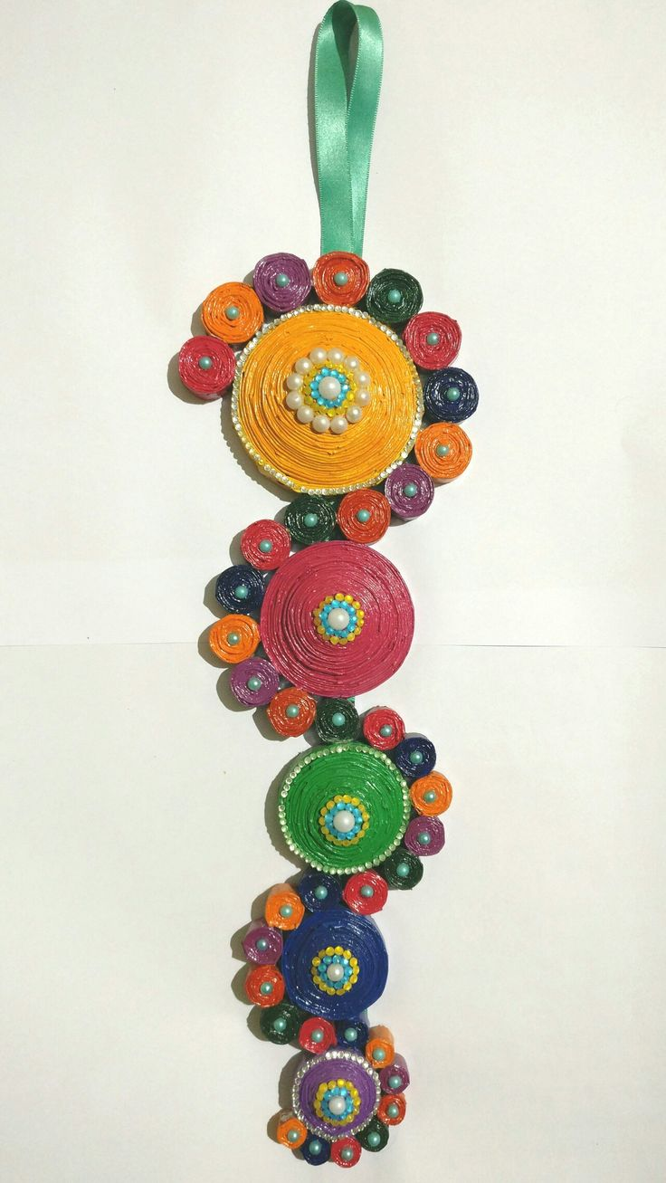 Newspaper quilled wall hanging