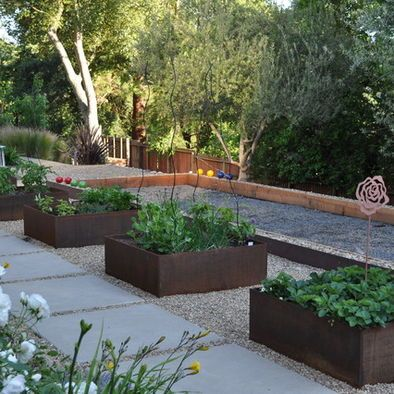 pretty raised beds next to the bocce ball court