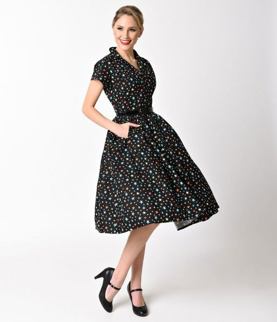 The sight of stars makes us dream, dames! A lovely midcentury frock from Bernie Dexter crafted from breezy lightweight black cotton and featuring wonderful multicolored stars printed over the entirety. Pure retro dress perfection, Kelly boasts a classic c
