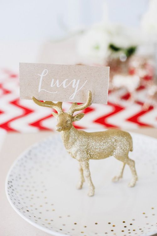 Glitter a toy deer for a christmas place setting. Put the name card in the antlers or attach to the neck with a ribbon.: