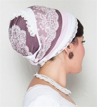 This unique and romantic tichel is made from a special purple fabric with a white-lace print and has appliqués of gathered lace and small pe...