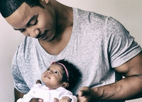 Actor Brian White holding his adorable daughter.