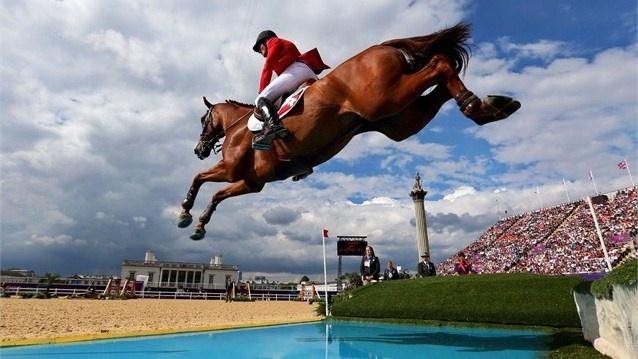 Water Jump! #london2012 Werner Muff of Switzerland riding Kiamon competes