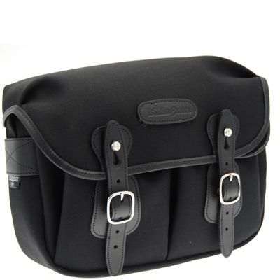 £99.95 Billingham Hadley Small Shoulder Bag - Black & Black. The Hadley Small is an immensely popular bag. The one piece main flap extends from the back of the bag, reducing the number of seams and enhancing the bag's weather resistance. Bellowed front pockets, with press studded expansion, are covered by individual flaps with press stud closure. The Quick Release System allows rapid access, while buckles provide precise adjustment.