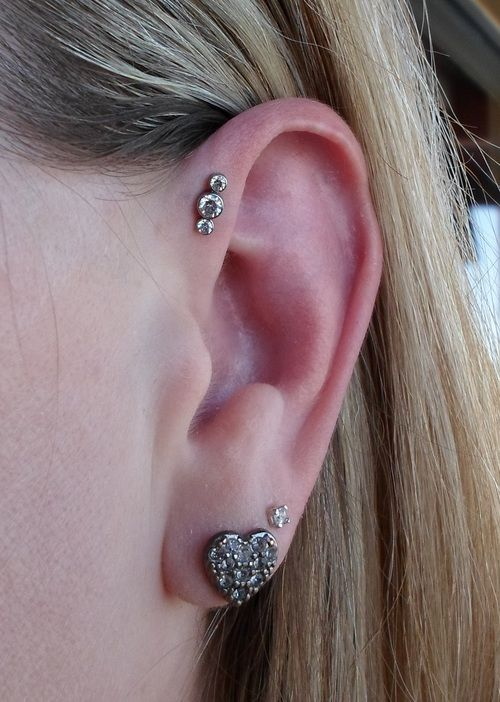 Not Classy Body Art's work but great idea - If you don't have room for a triple helix piercing, you can fake it with a custom piece from Anatometal. 16g forward helix with this custom triple gem.