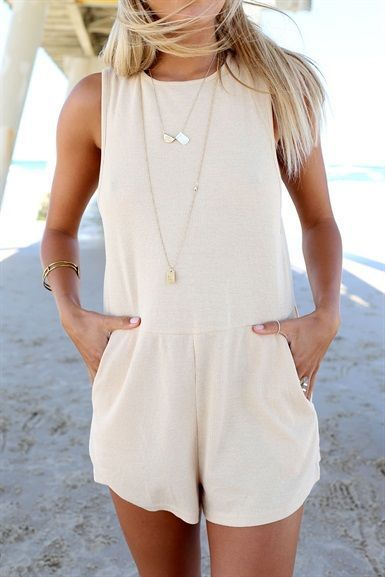 Classic and versatile cream romper paired with mini jewelry. A perfect summer look!