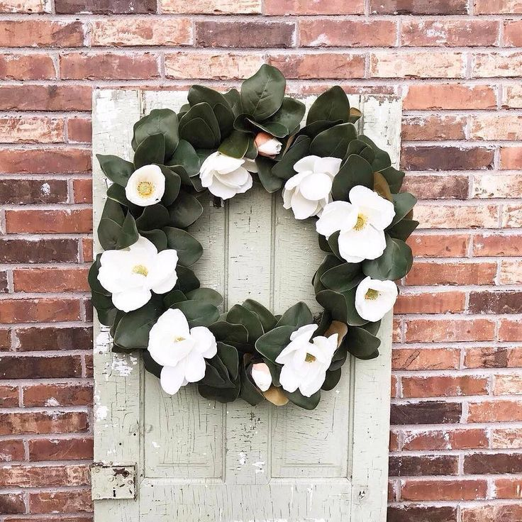Another decor idea from a creative #pier1 customer: @addyroseinteriors combined an old door and our Faux Magnolia Wreath to make this stunning piece for her back patio.  #pier1love #wreath