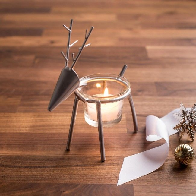 Give your holiday decor a festive kickstart with the Prancer Icon Tealight Holder.