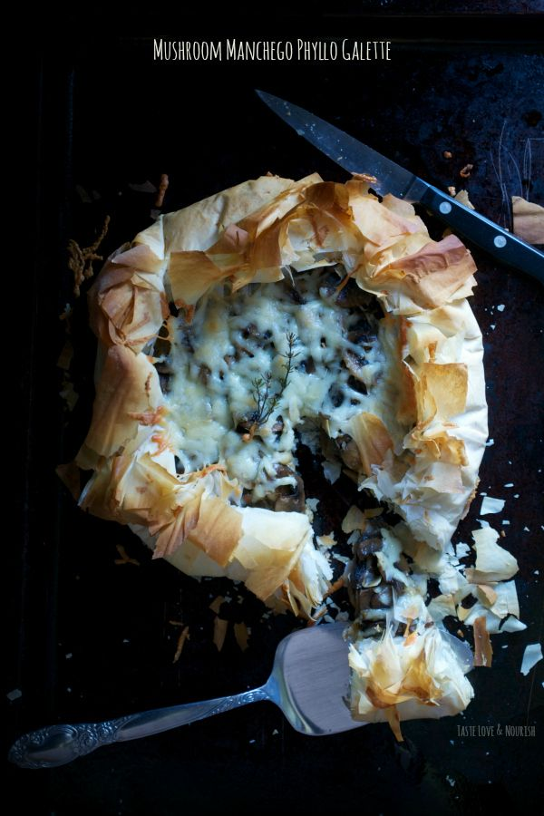 Deeply browned mushrooms and buttery manchego cheese sit pretty amidst a cloud of light and flaky phyllo making a perfect appetizer.