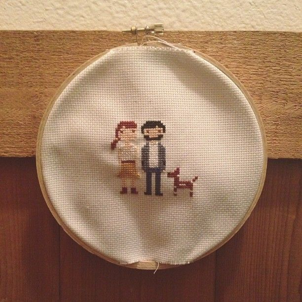 Cross stitching family portrait. Photo by katieanndenis