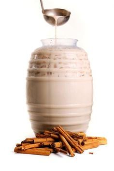 Aguas frescas:Horchata-rice,cinnamon stick, almonds all soaked in water over night and then blended and strained and then added sweetend condensed milk and vanilla served over ice and sprinkled with cinnamon