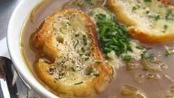 Beefy French onion soup is made in the slow cooker, then topped with the traditional slice of toasted French bread and a savory mixture of four cheeses, then broiled until browned and bubbling. It's fun to let people assemble their own bowls, too.