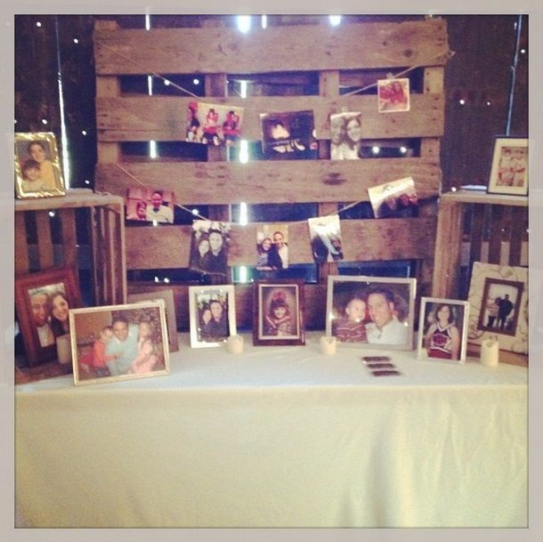 Memory table with pallet backdrop   Peach, coral & mint rustic-chic barn wedding