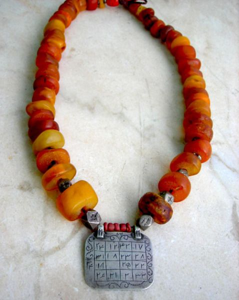 """BERBER necklace with qabbalah - """"this amber necklace carries a silver pendant, chiselled with the diagram of the qabbalah. In short: it is a mystique technique, using algebric formulas to reach God. In this case used as an amulet against evil. In place of the numbers (as it is here) they can also use letters, with the same value."""""""