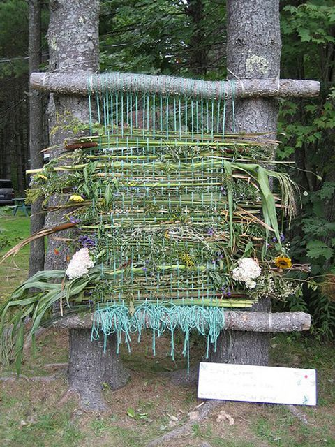 Giant Outdoor Weaving Center  -- Create a woven masterpiece outside. Flowers, sticks, and found objects are woven together.