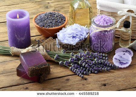 Spa lavender concept. Lavender oil, lavender flowers, handmade soap and sea salt with burning aromatherapy candle.  - stock photo